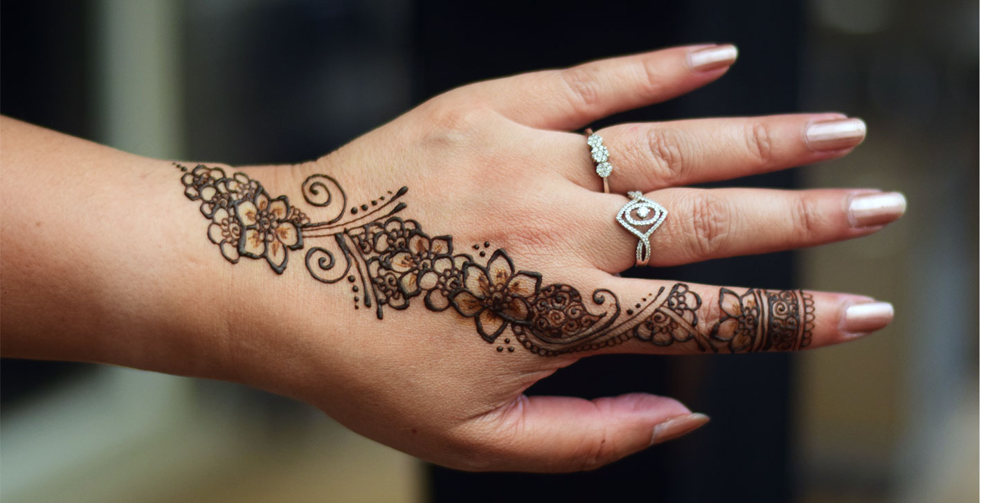 A simple henna design on a hand